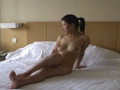 Asian chick poses and fucks for movie