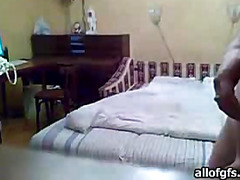Unshod guy beside the bed