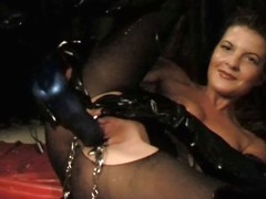 BDSM warm german in latex spreads her pussy with clamps