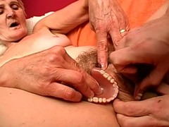 Blonde granny Irene plays with will not hear of artificial teeth greatest extent being fucked