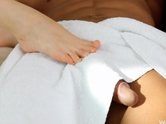 Sneaky chick gives a guy a footjob when he isn't with bated breath