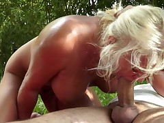 A blonde with a priceless old ass is giving a blow job to a dude