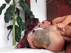 A tattooed big ass minx is sucking dick and that babe is doing loads more